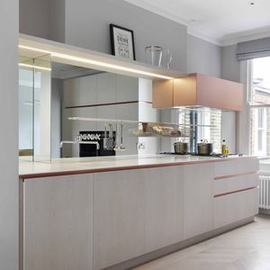 A London kitchen loaded with brass accents