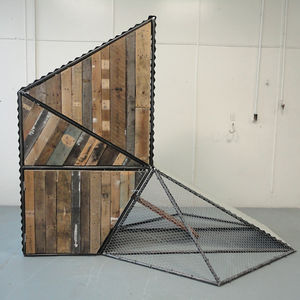 Students cut corrugated metal and pulled pallets apart to create Chicken Circus, which opens above and below to fill feed and collect eggs.