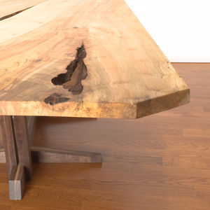 """Canada's <a href=""""http://cherrywoodstudio.ca/"""">Cherrywood Studio</a>, who designed this table, uses locally-sourced large urban hardwood trees that would otherwise be destined for landfill sites."""