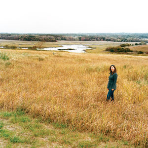 The tall vegetation surrounding Carrie Grassi, Freshkills Park land-use and outreach manager, grows atop what was formerly the world's largest landfill: 150 tons of (mostly) garbage, accumulated over more than half a century.