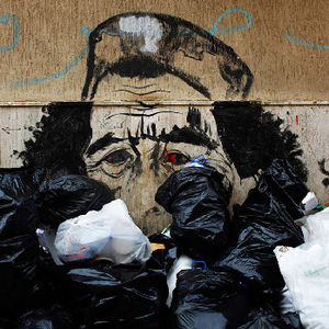 "Photojournalist Finbarr O'Reilly documented anti-Qaddafi sentiments strewn across walls and on posters in Libya. Photo via <a href=""http://lens.blogs.nytimes.com/2011/03/15/caricaturing-qaddafi/"">The New York Times</a>."