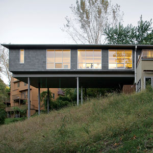 a lot to love house exterior from hillside
