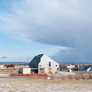 The Active House sits on a sloping plot on the outskirts of Aarhus, Denmark, with views to the south over the sea.