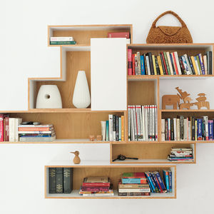 The house lacked significant storage space when the family moved in, so De Waart designed bookcases to custom-fit their favorite display items.