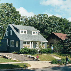 Architect Christian Dean and his sons Quentin (left) and Owen (right) tend to their front yard in the Linden Hills neighborhood where their modest Cape Cod house is par for the course. The addition Dean and his colleagues at City Desk Studio designed is a