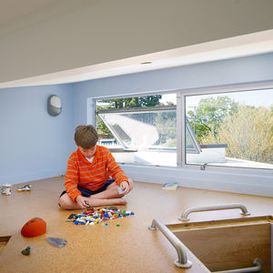 Modern attic playroom by the window