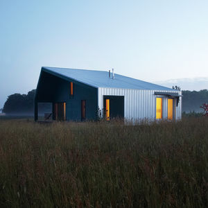 Sustainable home with galvanized steel shed roof and siding