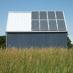 Modern home with solar roof panels by Sharp