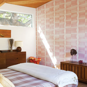 Modern master bedroom with Modernica bed and printed wallpaper