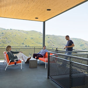 Modern outdoor deck with wooden ceiling and metal fence