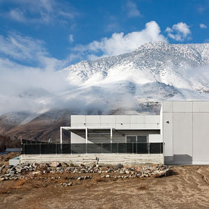 Modern prefab house with white facade in Sierra Nevada mountains