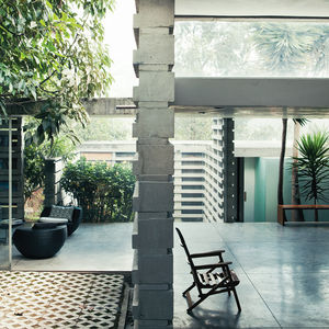 Modern courtyard with glazed walls and stacked concrete forms