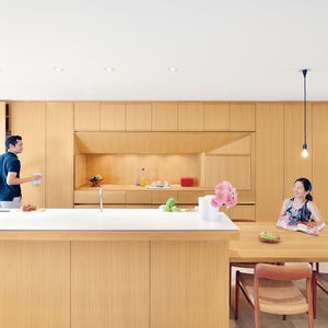 Modern kitchen with long countertop and oak cabinetry
