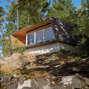 Sustainable cabin with hooded deck exterior near Vancouver