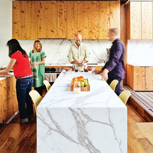 modern kitchen with marble countertop and wooden cabinets