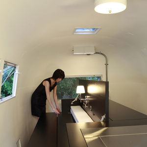 renovated kenchikukagu airstream atelier opa woman opening bed bottom