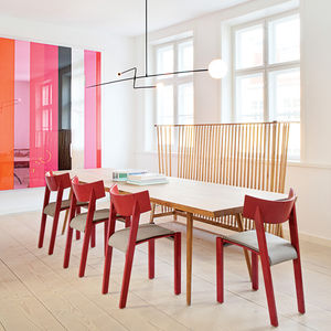 modern dining room with red chairs