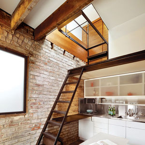 San Francisco guesthouse with kitchen and dining table and stairs to bedroom
