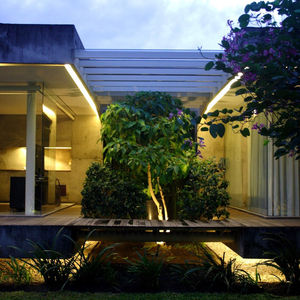 the natural bridge between old and new construction in a home in Indonesia