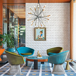 midcentury-inspired living room with Platner chairs and tile wall