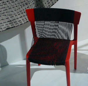 red and black woven chair