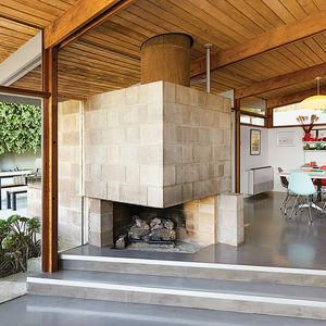 modern dwellings kalmic house quincy jones dining area cinder block fireplace