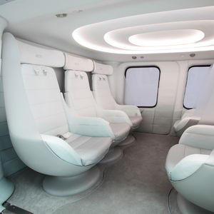 VIP helicopter interior cabin with white leather seats
