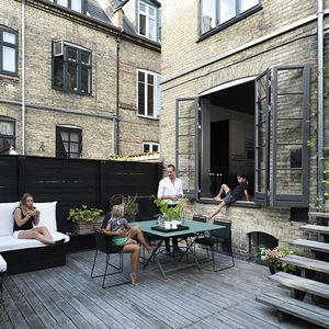 monochromatic copenhagen townhouse deck patio