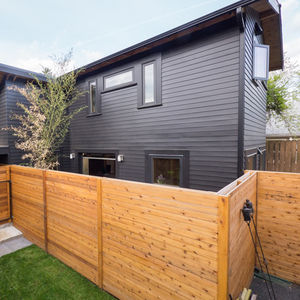 portland adu black exterior wood fence