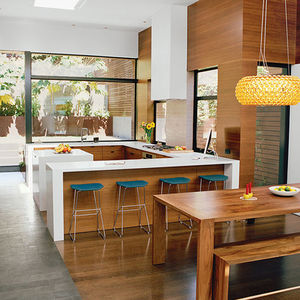 object lesson san francisco renovation kitchen walnut veneers caesarstone countertops pendant table bench
