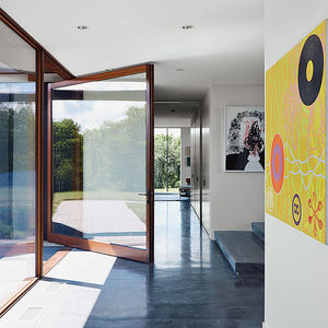 el top rises wisconsin pivot door archispec foyer concrete floor