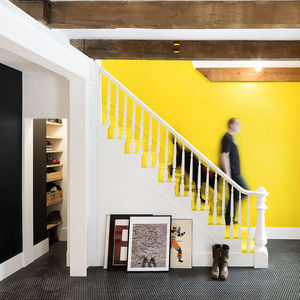 montreal rowhouse renovaton entryway stairs yellow