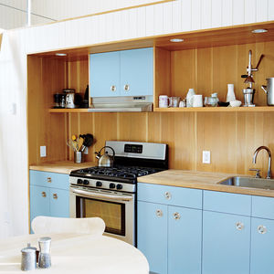 Modern small space Rhode Island cottage with ikea cabinets, loft, and Doug Mockett doors and pulls