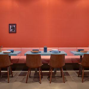 The burnt-orange interior of Kreuzberg, Berlin, restaurant Louis Pretty
