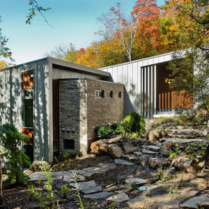 Eramosa limestone facade of Quebec vacation home by boom town.