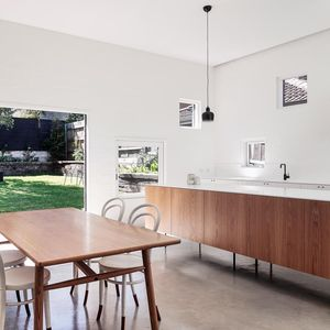 Dining area and kitchen in bungalow with a modern addition