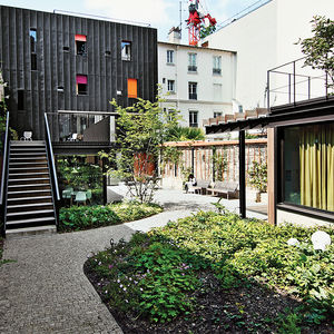 Modern Parisian adolescent home renovation by Damien Brambilla with outdoor garden and facade