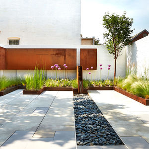Renovated DC Row House backyard with Cor-Ten steel.