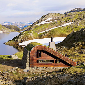 distant structure lakeside prefab norway facade stones green roof
