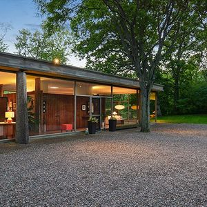 Exterior of 20841 Oak Lane Drive house by H.P. David Deever Rockwell
