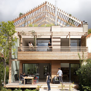 Cedar facade of eco-friendly prefab Paris home by Djuric Tardio Architectes