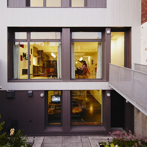 home for good renovation montreal family rear facade steel cladding footbridge garden