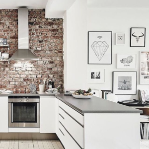 Kitchen with a brick wall and graphic art