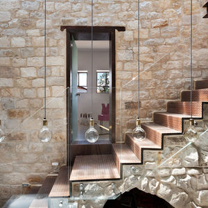 Limestone walls and original stone stairs in a renovated home in northern Israel