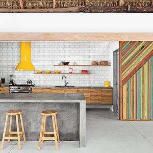 modern beach house thatch roof kitsch concrete island sliding door
