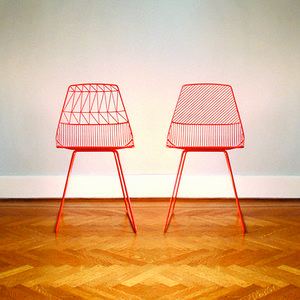 Powder-coated iron side chair in neon orange