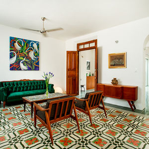 Mexican living room with bright patterned floor tile