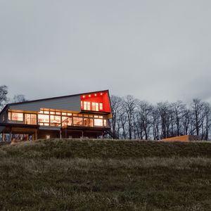 Hudson Valley home with fiber cement-board cladding and steel standing-seam roof.