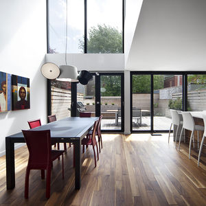 Dining room with Tam Tam light by Marset in Montreal renovation by Blouin Tardif.