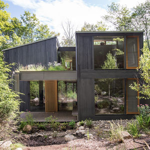 moving mountains upstate new york family vacation home facade tamarack cladding